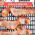 juicy cooked bacon sitting in an air fryer basket