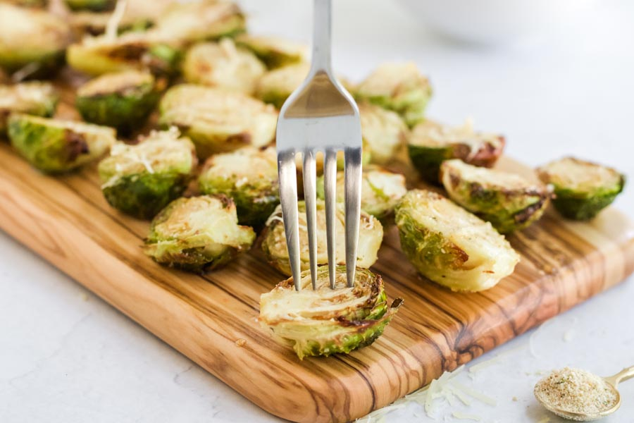 a fork stabbing a crunchy brussels sprout