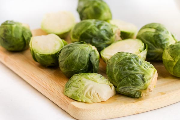 sliced brussels sprouts on a board