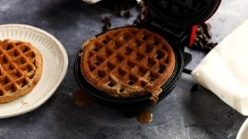 a chocolate waffle cooking in a waffle maker