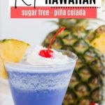 a keto cocktail that is frozen and blue in front of a big pineapple