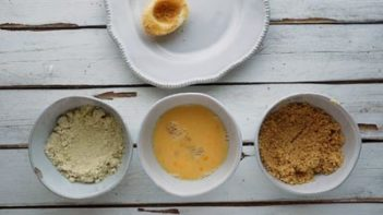 three bowls with almond flour, egg and pork panko in them