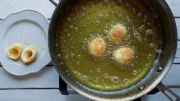 frying hardboiled egg whites in oil in a skillet