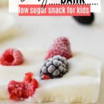 white yogurt bark topped with frozen blackberries and raspberries
