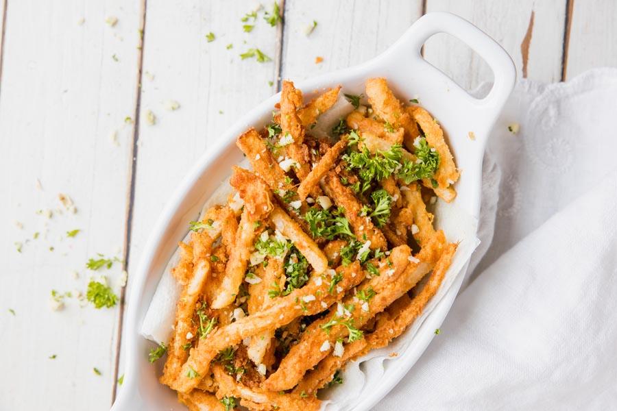 overhead view of a basket of garlic parm jicama fries