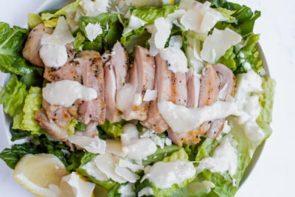 chicken caesar salad ingredients in bowl