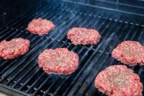 salt and seasoning sprinkled on burger patties