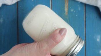 shaking a mason jar with cream