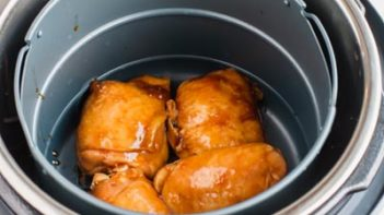 pulling cooked chicken teriyaki out of instant pot sous vide