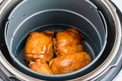 chicken teriyaki in the air fryer basket of the instant pot duo crisp
