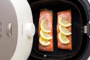 salmon fillets in an air fryer basket
