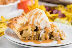 a slice of keto apple pie with vanilla ice cream dripping down and caramel sauce