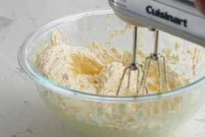 mixing butter and sweetener in a bowl