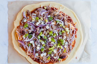 add toppings to bbq pulled pork pizza