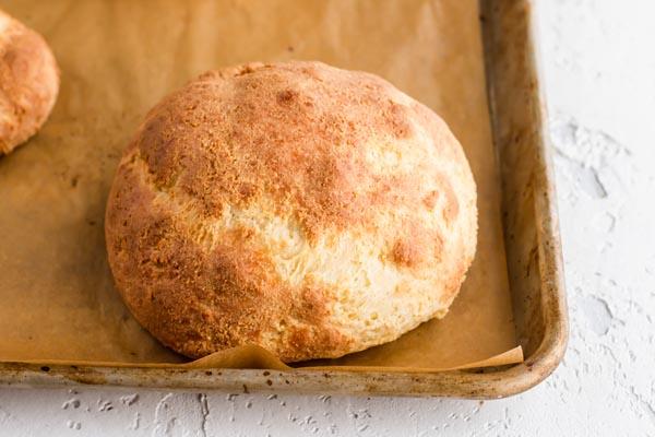 big keto roll on a baking tray