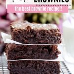 three brownies stacked with parchment paper in between