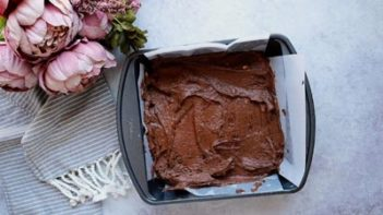 brownie batter in a parchment lined baking dish