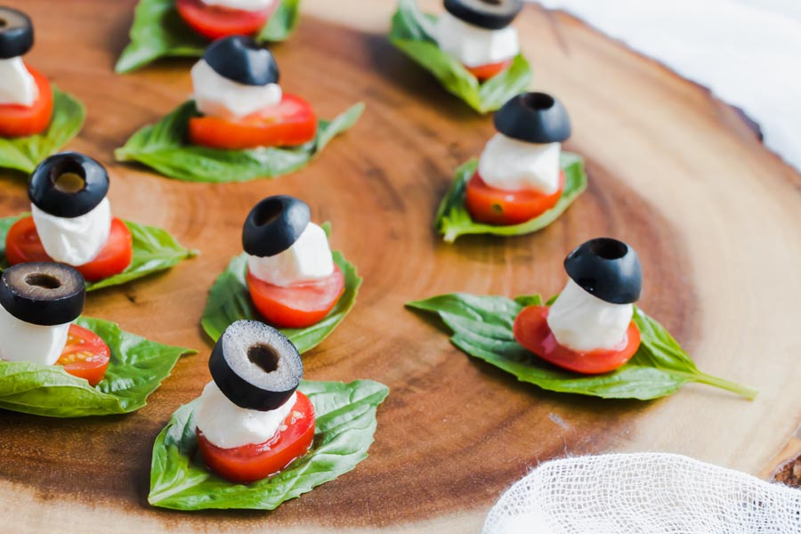 caprese salad bites on a tray