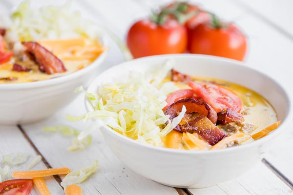 two bowls of creamy soup with bacon on top