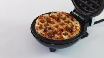 cook keto waffle in the waffle iron