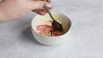 stirring in pink food coloring to sugar free white chocolate