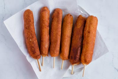 dry keto corn dogs on paper towel