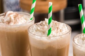 three frappuccinos with whip and straws