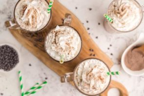 four frappuccinos with three on a wooden board