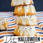 a stack of mini bundt cakes decorated like ghosts for halloween