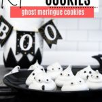 a plate with ghost meringue cookies on it with a boo in the background
