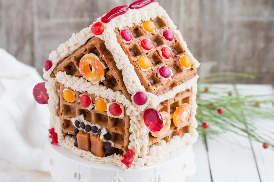 keto gingerbread house on a stand