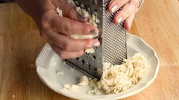 shredded dough with a cheese grater