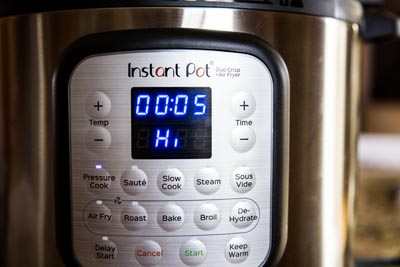 instant pot set to pressure cook high for 5 minutes