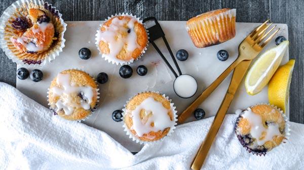 glazing a bunch of keto muffins