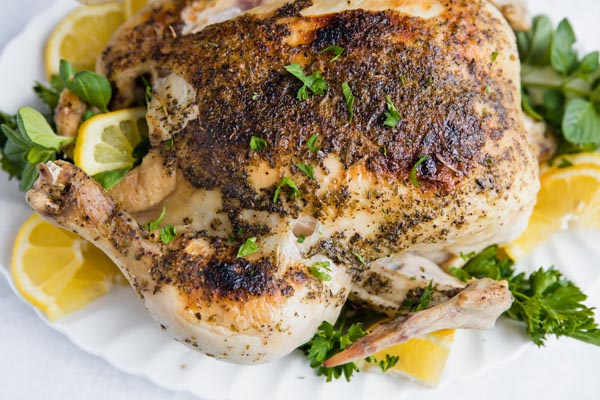 closeup overhead view of a whole rotisserie chicken with crispy golden brown skin