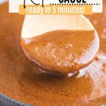 spoonful of keto mole sauce from a cast iron skillet
