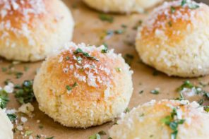 a golden bread puff topped with parmesan and parlsey