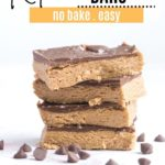 four peanut butter bars stacked up with chocolate chips around