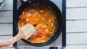 scrambling eggs with a wooden spatula