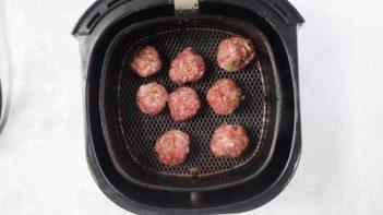 keto pizza meatballs in an air fryer basket