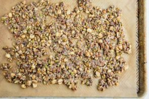 granola spread out on a baking tray