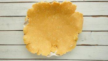 thin pie crust dough over a pie plate