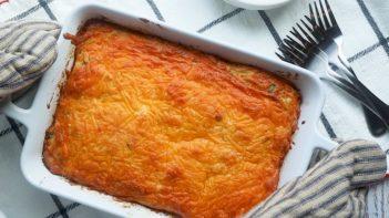 placing down a hot cheesy breakfast casserole