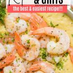 a layer of cooked shrimp on a pile of grits topped with chopped parsely