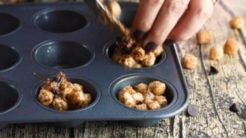 scooping cereal smore mixture into a muffin tin