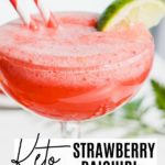 a frozen daiquiri with a lime wedge and two striped straws