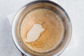 butter and golden monk fruit bubbling in a saucepan