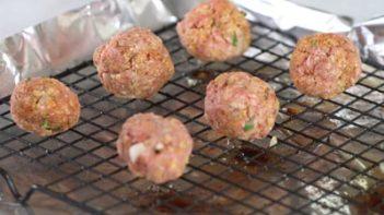 gluten free keto taco meatballs on a wire rack baking tray