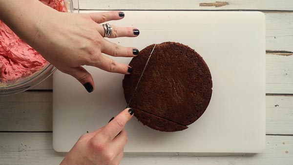 cutting the edges off a chocolate cake