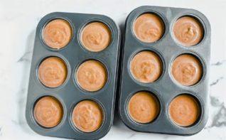 pumpkin pie filling in muffin tin